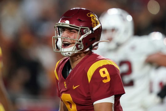 Southern California Trojans quarterback Kedon Slovis (9) celebrates after a touchdown in the second quarter against the Stanford Cardinal at Los Angeles Memorial Coliseum.