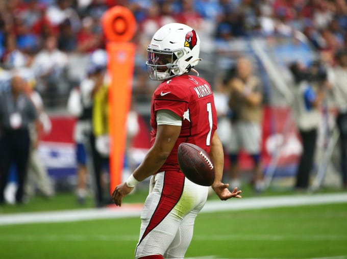 Cardinals quarterback Kyler Murray (1) tosses the ball to an official during a game against the Lions on Sept. 8 at State Farm Stadium.