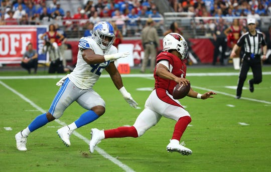 Kyler Murray is chased by Lions linebacker Devon Kennard in the second half.