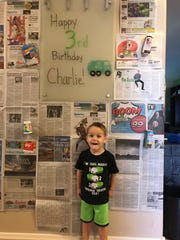 "Charlie London, 3, celebrated his birthday with a ""Garbage Truck"" themed party."