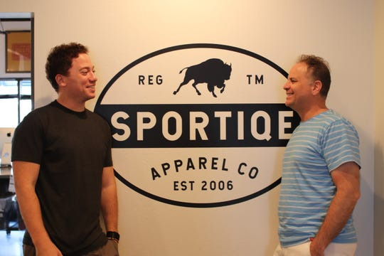 Sportiqe CEO and Co-Founder Matt Altman, right, chats with Co-Founder and Principal Jason Franklin, left, at the company's Tempe headquarters on Sept. 6, 2019.