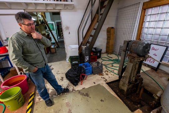 Bill Barrons, owner of Anglers Outfitters in St. Clair, talks about a water pump from 1947 located in the store Monday, Sept. 9, 2019. The well, which has been in use since 1890, was originally used for mineral baths.