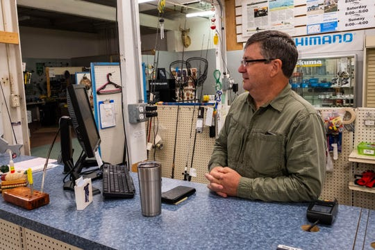 Bill Barrons, owner of Anglers Outfitters, works at the store's front counter Monday, Sept. 9, 2019.