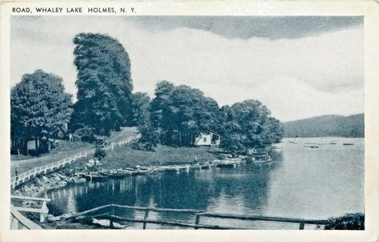This vintage postcard shows the west side of Whaley Lake in the Town of Pawling, which attracted many seasonal visitors. The dirt road adjacent to the lake (today's Route 292) runs between the hamlets of West Pawling to Holmes.