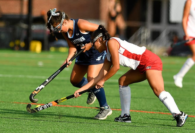 Dallastown's Sara Beck, left, and Maggie Grim of Susquehannock battle for the ball near mid-field, Monday, September 9, 2019.John A. Pavoncello photo