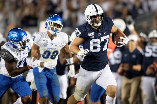 Penn State tight end Pat Freiermuth (87) scores a touchdown in the third quarter of an NCAA college football game against Buffalo in State College, Pa., on Saturday, Sept. 7, 2019. (AP Photo/Barry Reeger)