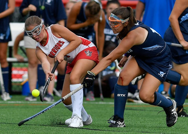 Susquehannock's Megan Stiffler passes the ball while being covered by Gloria Fleming of Dallastown, Monday, September 9, 2019.John A. Pavoncello photo