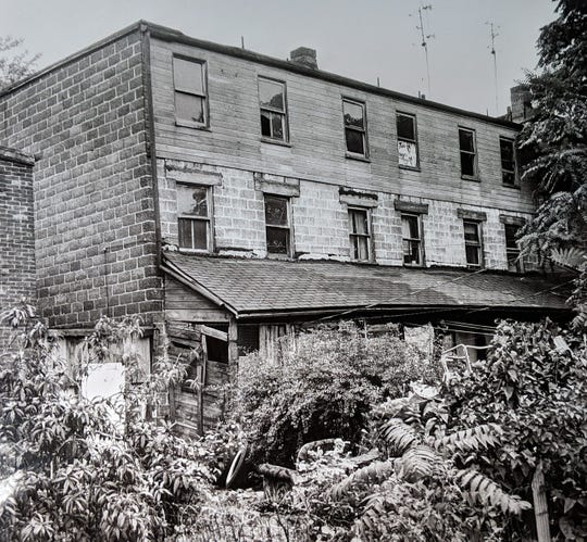 This scene shows the rear of a residence on York's West Hope Avenue in 1963. Members of the black community complained to city hall in the 1960s about such subpar housing, and rioting erupted in this vicinity in the late 1960s.
