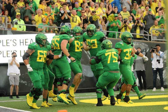 Oregon Ducks offensive lineman Brady Aiello (82) celebrates with teammates after scoring a touchdown against the Nevada Wolf Pack in the first half at Autzen Stadium.