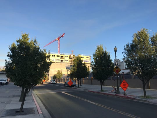 A construction crane is poised over The Deco at Victorian Square in September 2019.