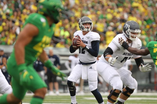 Wolf Pack quarterback Carson Strong (12) looks to throw the ball against the Oregon Ducks in the first half at Autzen Stadium.