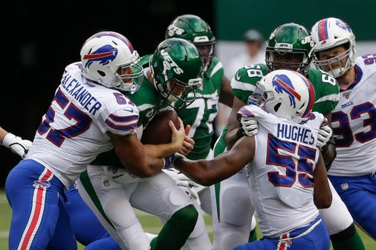 Lorenzo Alexander (57) of the Buffalo Bills sacks New York Jets quarterback  Sam Darnold (14) during the second half of an NFL football game Sunday, Sept. 8, 2019, in East Rutherford, N.J.