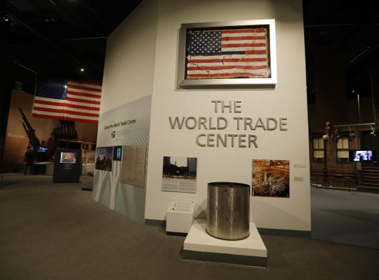 At the entrance of the World Trade Center Gallery is a U.S. flag recovered from the World Trade Center by the New York State Police.