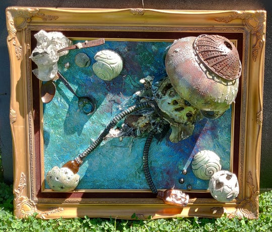 """This piece is part of the 'Art from the Ashes: Seeds of regrowth' exhibit of work made from Carr Fire debris at downtown Redding venues. The show opens in October. Title: """"Jelly Fish"""" by Sheila Preston-Ford"""