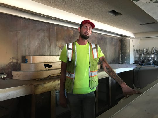 Mitchell Johnson, who is in the process of buying The Tropics in Redding, stands behind the bar that he hopes to revive. Johnson worked as a bartender at The Tropics a few years ago.