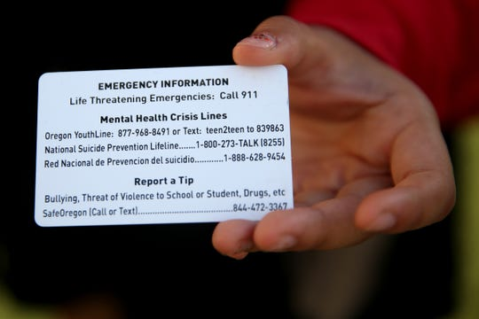 Student IDs now include crisis resource numbers on the back. Photographed at North Salem High School on Sep. 3, 2019.