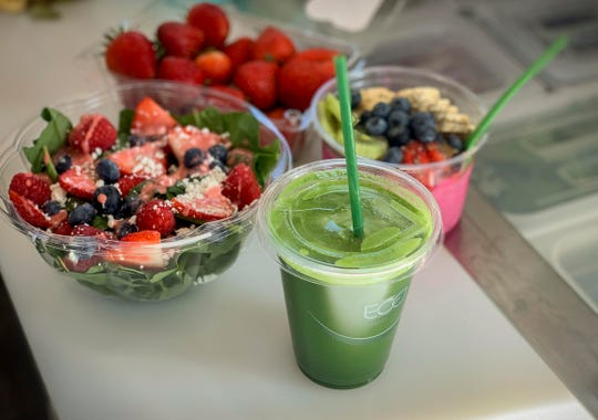 Clockwise from the front, the Pick Me Up Power Green  juice, Nuts About Berries salad and the Pitaya Bowl are all available at Smooth, a new business offering healthy, grab-and-go foods that opened September 7, in the parking lot of The Fussy Duck at 3170 South Commercial in Salem.