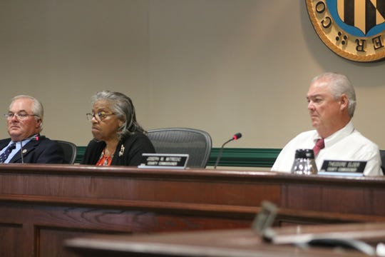 From left: County commissioners Madison Bunting Jr., Diana Purnell and Joseph Mitrecic listen to a proposal on Aug. 20, 2019 in Snow Hill.