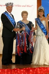 """Krewe des Ambassadeurs-Minden King XIX Joe Ellis Michael and Queen Venetia Michael flank Krewe Captain 2019 and 2020 Mahala Hutto at the """"Red, White and Blue!"""" Coronation Gala and presentation of the Royal Court."""