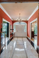 The entryway features marble floors.