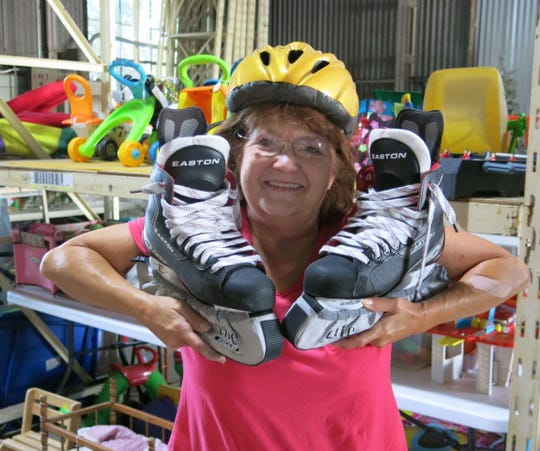 Bobbie Wyche shows off new skates and a helmet which are among offerings at the Rummage Sale. The size six and half skates were nestled in their original box. Original price tag: $199, but are being sold at the rummage sale for $50.