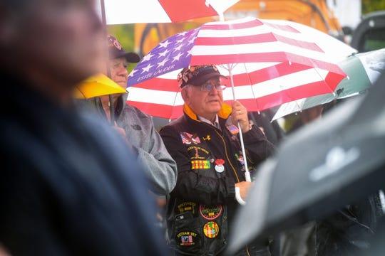 A Vietnam War veteran stands in the rain as he listens to the program at the groundbreaking ceremony for the first veterans cemetery in South Dakota on Monday, September 9, in northeast Sioux Falls.