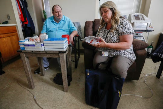 Tina Shannon, a community health worker with Jordan Valley Community Health Center, talks with her client Anthony Delana in his apartment at Franciscan Villa on Wednesday, Sep. 4, 2019, in Springfield, Mo.