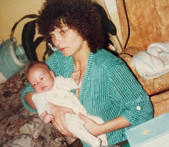 Cynthia A. Smith, a California native who lived in Aurora, Missouri for several years before her death in 1988, is shown in an undated family photo with one of her sons.