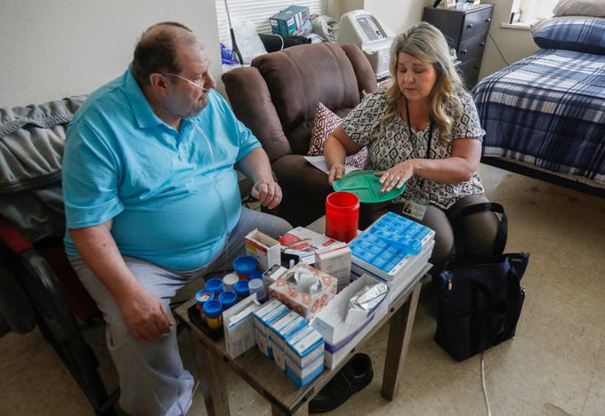 Tina Shannon, a community health worker with Jordan Valley Community Health Center, talks with her client Anthony Delana about portion control in his apartment at Franciscan Villa on Wednesday, Sep. 4, 2019, in Springfield, Mo.