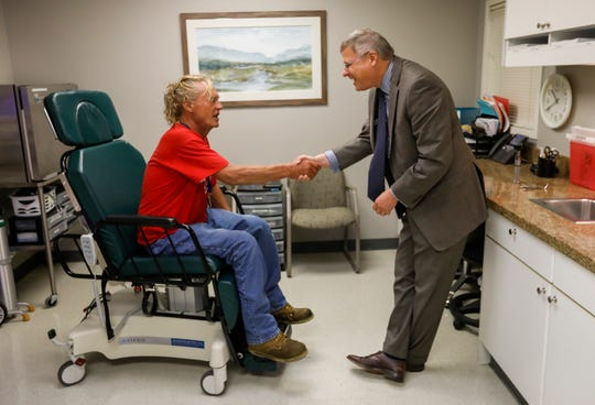 Dr. Matthew Kienstra shakes hands with Charlie Orman after consulting with him about his eye at the Fremont Clinic at Mercy Hospital on Thursday, Sep. 5, 2019.