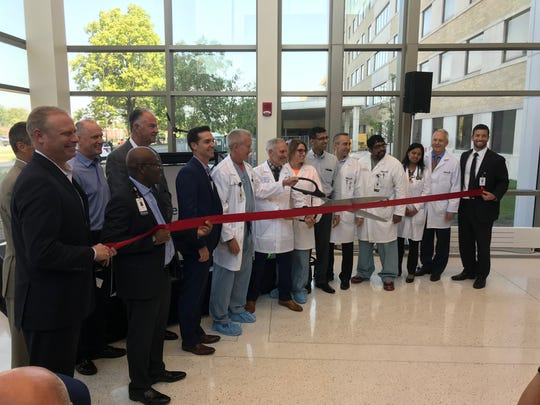 Mercy hosted a ribbon cutting for Phase II of the new Heart Hospital on Monday. This phase relocates the clinic space from Mercy Clinic - Whiteside and opens a dedicated entrance for heart patients, offering them valet parking for their doctor's visits.