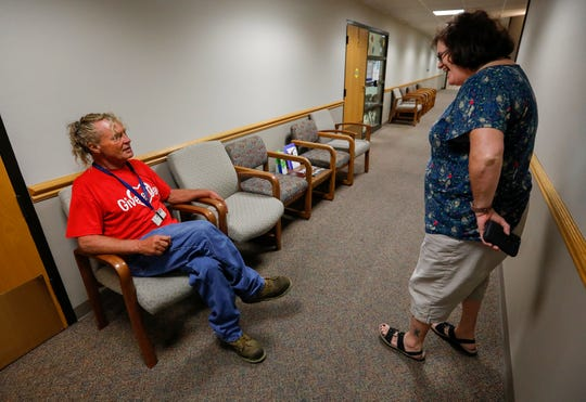 Charlie Orman jokes with his Burrell caseworker Linda Hamer outside of the Fremont Clinic at Mercy Hospital on Thursday, Sept. 5, 2019 in Springfield, Mo.