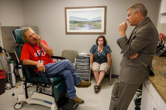 Dr. Matthew Kienstra listens as Charlie Orman describes how he needs to cover one eye in order to see clearly at the Fremont Clinic at Mercy Hospital on Thursday, Sep. 5, 2019.