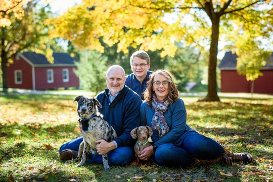 Spokane Superintendent Della Bell-Freeman and her husband, Kevin Freeman, and son Darras Bell, along with family dogs OY and Bruiser. Darras is a sophomore at Spokane High School.