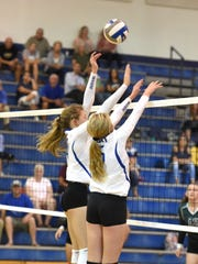 Although not one of the taller players on the team, Fort's Maddie Painter (5) was praised by her coach for her blocking ability.
