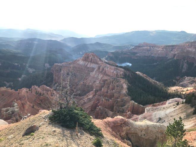 """Smoke from the """"Chessman Canyon Fire"""" in Cedar Breaks National Monument is seen from a nearby hilltop. The fire was started by lightning, according to fire crews."""