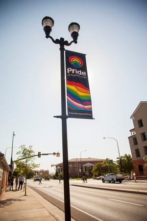 Workers place pride banners on St. George Boulevard in anticipation of Pride Week September 2019.