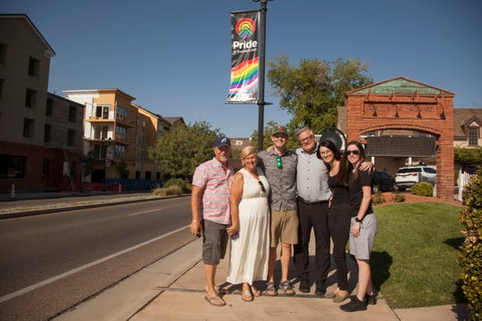 Representatives from Equality Utah and Pride of Southern Utah pose under a newly placed Pride banner on St. George Boulevard on Sept. 9 in anticipation of Pride Week in St. George, Utah.