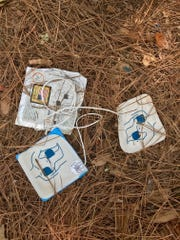 Used defibrillator pads could be seen on the ground Monday at a Tallahassee mobile home park where someone was shot and killed.