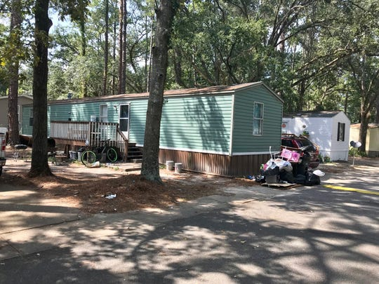 Someone was shot and killed early Saturday morning outside this mobile home in Brittany Estates in Tallahassee.
