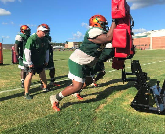 FAMU defensive lineman Richard Summers works on a blocking sled in preparation for the home opener versus Fort Valley State