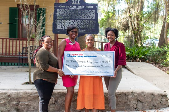 Capital City Bank donated $1,500 to the John G. Riley Museum and Research Center. Pictured, center, Althemese Barnes, founding director of the museum, with Paige Lee, Director of Education, and Catiana Foster, Exhibit & Programs Coordinator along with Capital City representative.