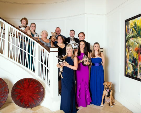 """H.A.L.O. No-Kill Rescue is celebrating13 years of saving animals' lives at its 2019""""Fur Ball."""" The Dec. 6 party is being planned by, from left, first row, Margaret Wall, Jacque Petrone and Allyson Bootes; second row, Rebecca Grohall and Ryan Jones; third row, Michele Nolte, Bruce McCullers and Aaron Johnson; top row,  Jan Howington and Amanda Jess."""