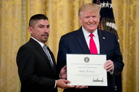 President Donald Trump presents a Certificate of Commendation to Robert Evans, one of five civilians celebrated for their heroism during the mass shooting in El Paso, Texas, during a ceremony in the East Room of the White House in Washington, Monday, Sept. 9, 2019.