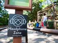 "A ""headphone zone"" sign at an area with primates at the Greenville Zoo."