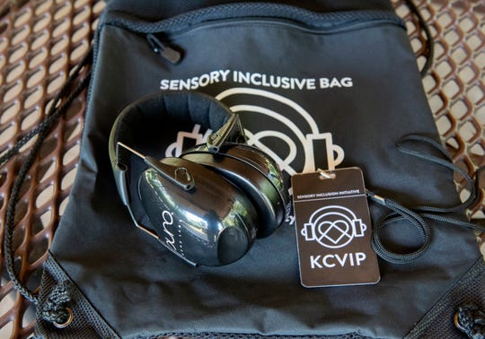A sensory inclusive bag from the Greenville Zoo with headphone, a fidget toy and a badge.