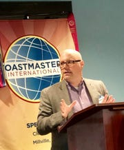 Chris Loftin, treasurer and vice president of education, Speak E-Z Toastmasters, speaks at a club meeting.