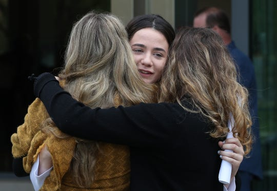 Sexual abuse survivor Nicole Chiapperino, center, hugs other survivors, Anastasia Overkircher and Eva Overkircher at Rockland County Court  Sept. 9, 2019. Their former gymnastics teacher, Joseph Lewin was sentenced to four years on felony sexual abuse charges.