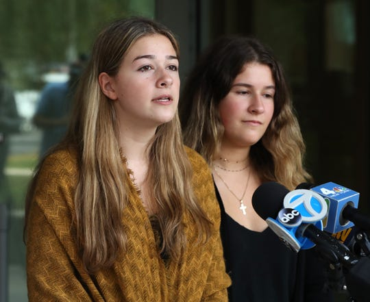 Sexual abuse survivors Anastasia Oberkircher, left, and Eva Oberkircher speak outside the Rockland County Court on Sept. 9, 2019. Their former gymnastics teacher, Joseph Lewin, was sentenced to four years on felony sexual abuse charges.