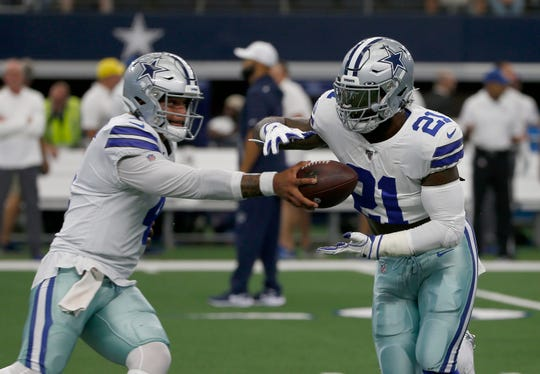 Dallas Cowboys' Ezekiel Elliott (21) takes the hand off from quarterback Dak Prescott (4) during warmups before a NFL football game against the New York Giants in Arlington, Texas, Sunday, Sept. 8, 2019. (AP Photo/Ron Jenkins)